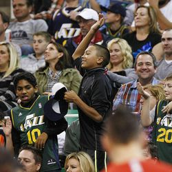 A group of young boys try to dance along with the Jazz dancers as the Jazz and the Rockets play Saturday, Nov. 2, 2013 in EnergySolutions arena. Jazz lost 104-93.
