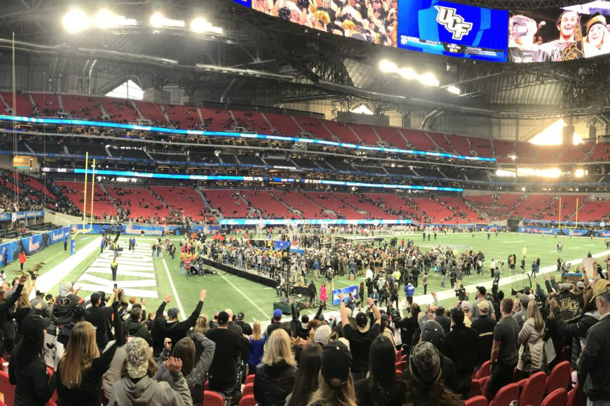 UCF fans celebrate their Knights defeating Auburn in the 2018 Chick-fil-a Peach Bowl at Mercedes-Benz Stadium in Atlanta. (Photo: Jeff Sharon)