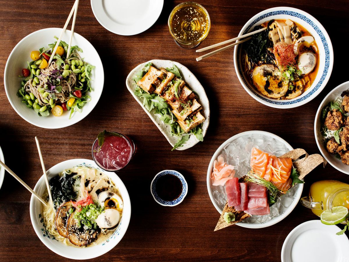 A table spread with Japanese dishes