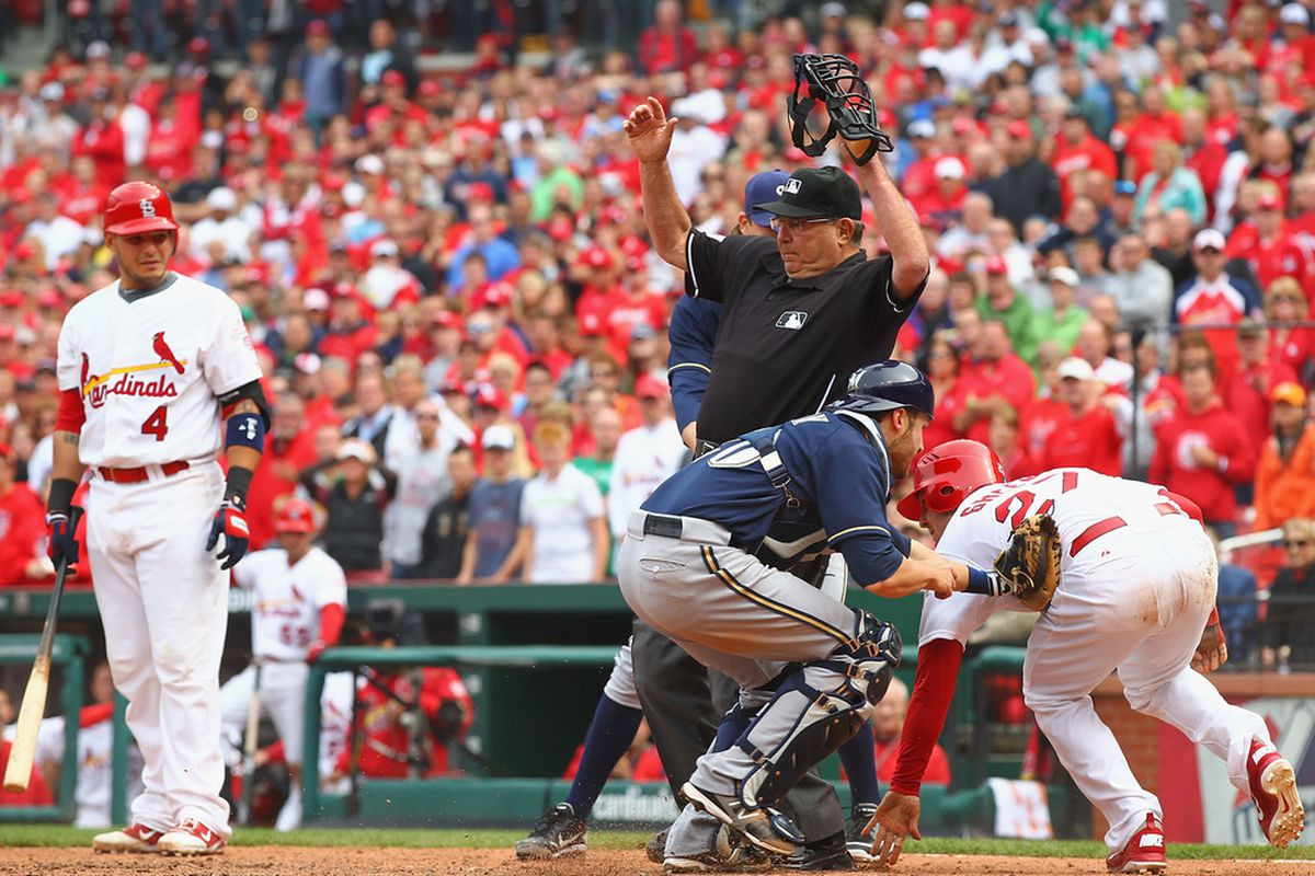 Jonathan Lucroy tagged out Tyler Greene at the plate to end Sunday's game.