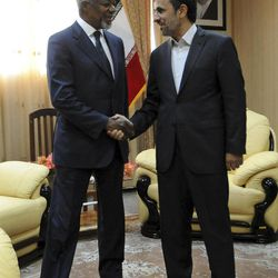 """In this photo released by the semi-official Iranian Students News Agency (ISNA), International envoy Kofi Annan, left, shakes hands with Iranian President Mahmoud Ahmadinejad, at the beginning of their meeting on the Iranian island of Qeshm, Wednesday, April 11, 2012. Annan, the U.N.-Arab League envoy, has been pushing Damascus to withdraw its troops from cities and halt all violence in 48 hours to salvage his peace plan. He has appealed to Syria's key ally Iran to support his plan to end the violence wracking the Arab country, saying that """"any further militarization of the conflict would be disastrous."""""""