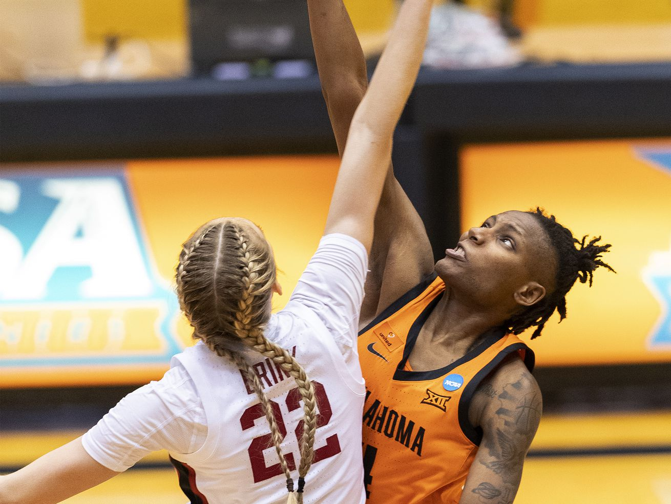 Oklahoma State forward Natasha Mack, right, and Stanford forward Cameron Brink (22) reach for the opening tip of an NCAA women's tournament second-round game in San Antonio on March 23, 2021.