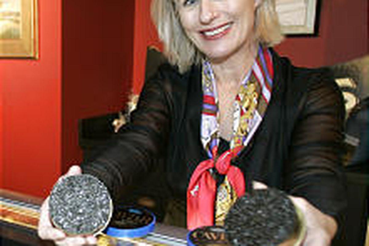 Betsy Sherrow, president of the gourmet retail store Seattle Caviar Co., holds tins of beluga caviar, left, and white sturgeon caviar.