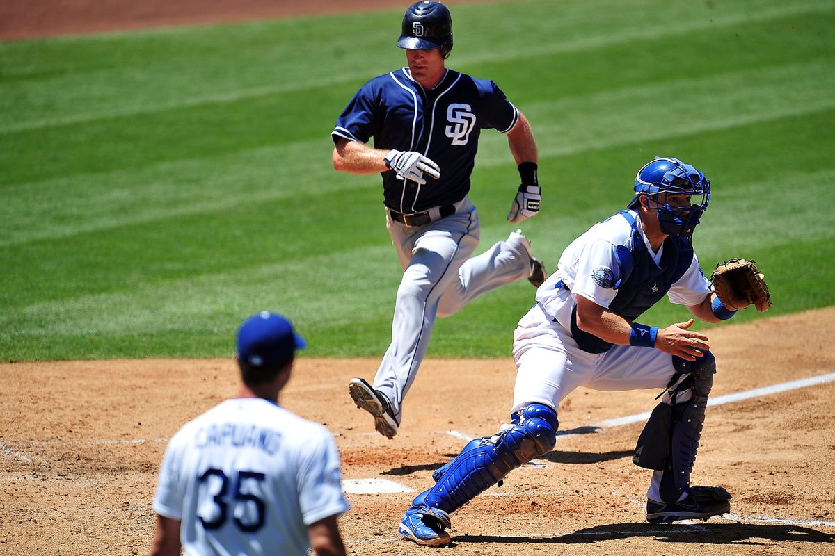July 15, 2012; Los Angeles, CA, USA; San Diego Padres second baseman Logan Forsythe (11) scores a run in the fourth inning against the Los Angeles Dodgers at Dodger Stadium. Mandatory Credit: Gary A. Vasquez-US PRESSWIRE
