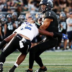 Corner Canyon's Cole Hagen tries to brush off Bingham's Sione Fotu on a run as they play in a high school football game at Corner Canyon on Friday, Aug. 30, 2019. Corner Canyon won 56-28.