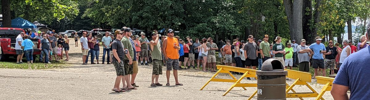 The crowd, most smartly hanging in the shade, watch the waterfowl blind draw at Marshall State Fish and Wildlife Area. Credit: Dale Bowman