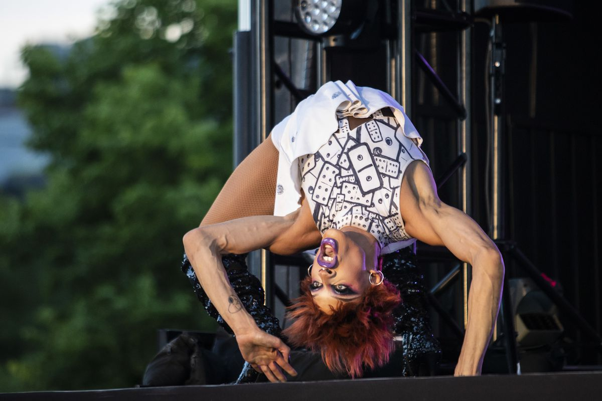 """Yvie Oddly, winner of the eleventh season of """"RuPaul's Drag Race,"""" performs one of her trademark backbends Friday night during Drive 'N Drag at Soldier Field."""