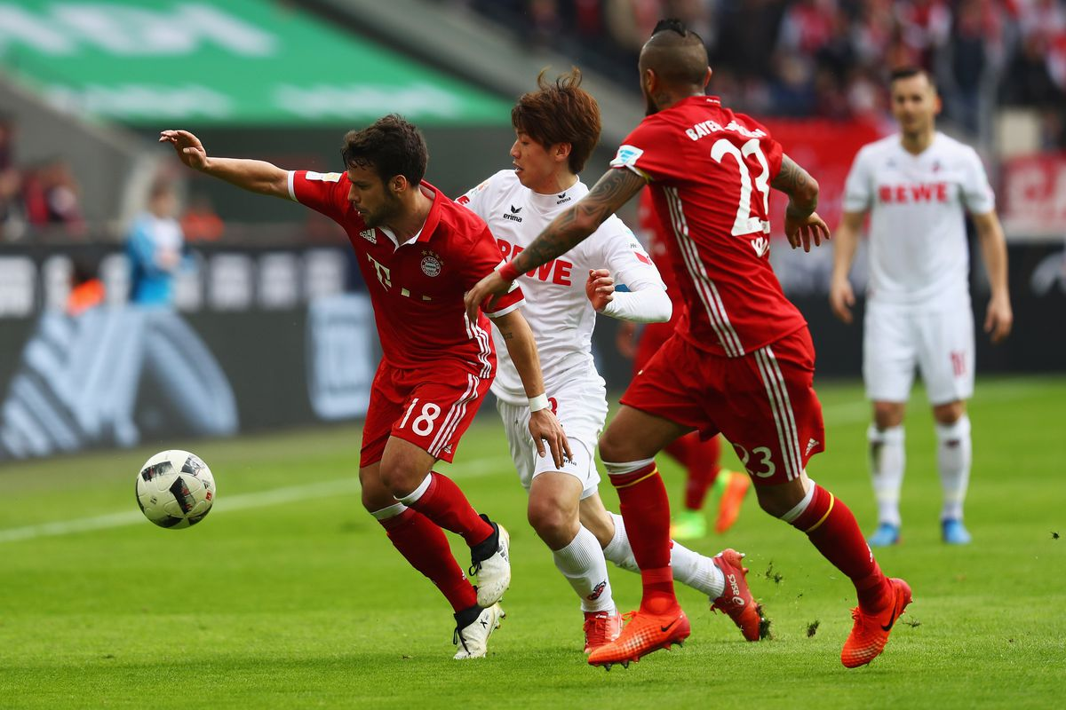 COLOGNE, GERMANY - MARCH 04: Yuya Osako of Koeln battles for the ball with Arturo Vidal and Juan Bernat of Bayern Munich during the Bundesliga match between 1. FC Koeln and Bayern Muenchen at RheinEnergieStadion on March 4, 2017 in Cologne, Germany. (Photo by Dean Mouhtaropoulos/Bongarts/Getty Images)