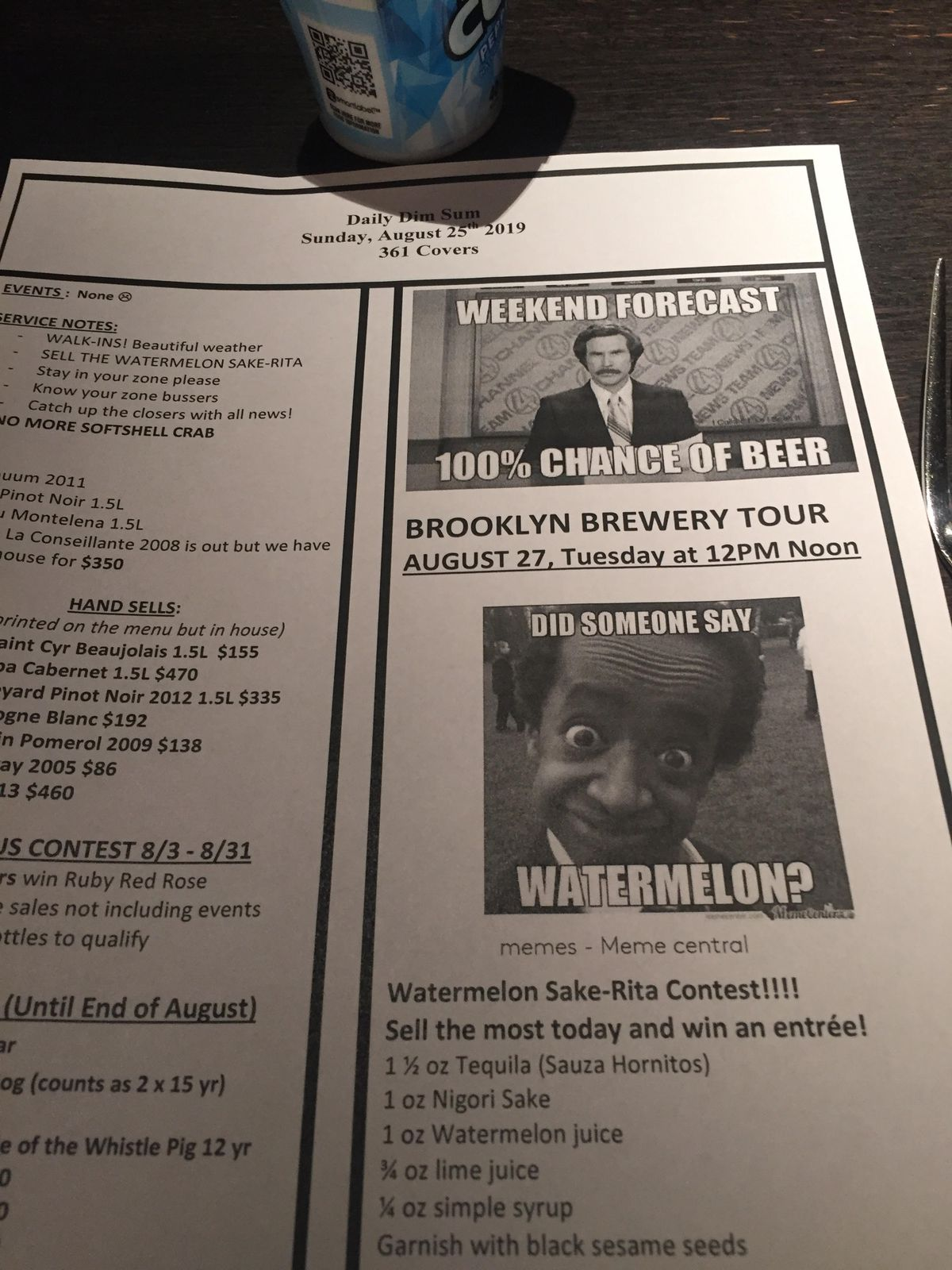A photograph of a meeting sheet from a restaurant with several specials outlined along with two memes