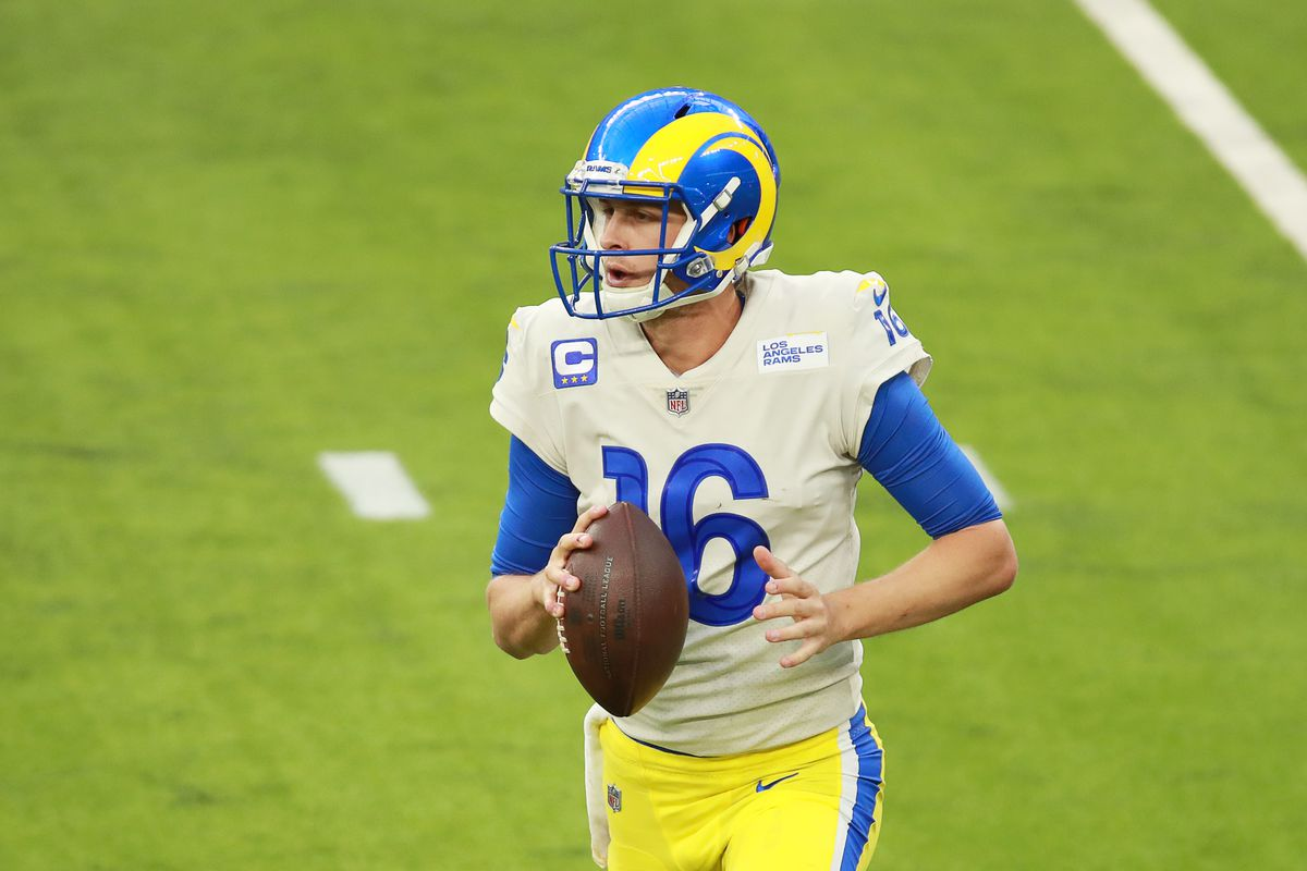 Jared Goff #16 of the Los Angeles Rams runs with the ball in the fourth quarter against the New York Jets at SoFi Stadium on December 20, 2020 in Inglewood, California.