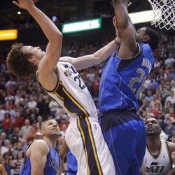 Utah Jazz guard Gordon Hayward (20) tries to push up a shot over Dallas Mavericks center Ian Mahinmi (28) as the Utah Jazz and the Dallas Mavericks play Monday, April 16, 2012 in Salt Lake City.