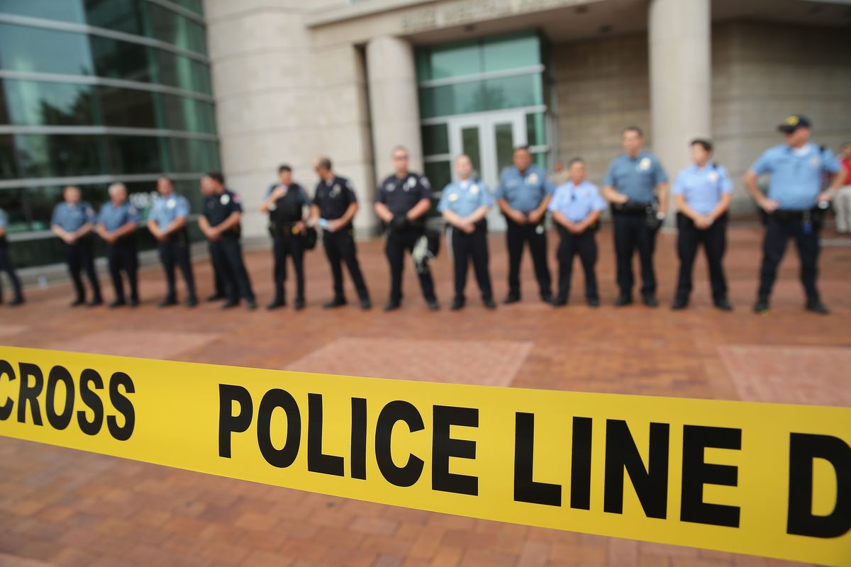 Police guard the Clayton, Missouri, courthouse where a grand jury has begun hearing evidence about the shooting of Michael Brown.