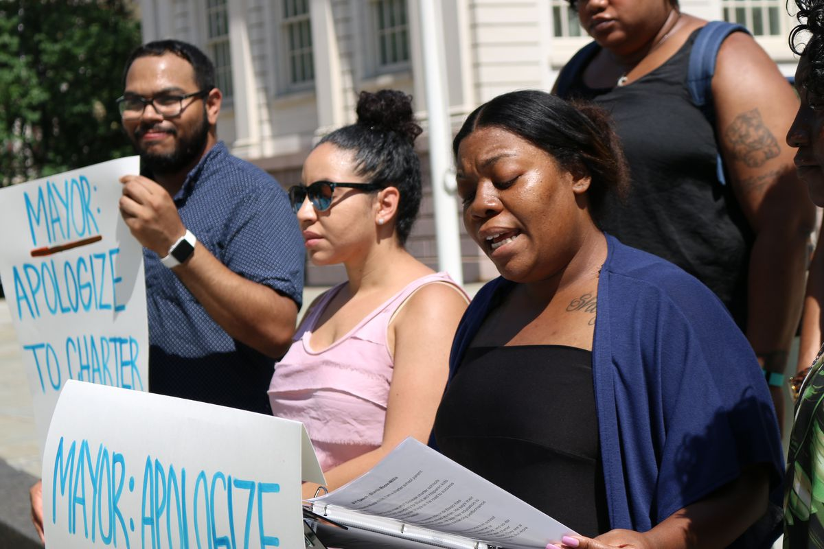 Sharita Moore-Willis, whose daughter will start first grade at Girls Prep Lower East Side this fall, speaks at a rally on the City Hall steps demanding an apology from Mayor Bill DeBlasio for his earlier comments on charter school test scores.