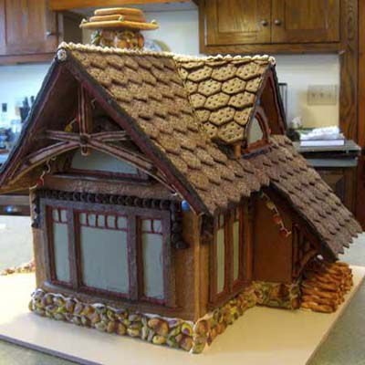 Gingerbread chalet with detailed hexagon patterns on the roof.