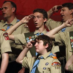 Hundreds of Boy Scouts from the Great Salt Lake Council salute the flag and sing the national anthem as it is posted at a banquet held in commemoration of the 100th birthday for the Great Salt Lake Council of the Boy Scouts of America at the Salt Palace in Salt Lake City on Thursday, Feb., 25, 2010.