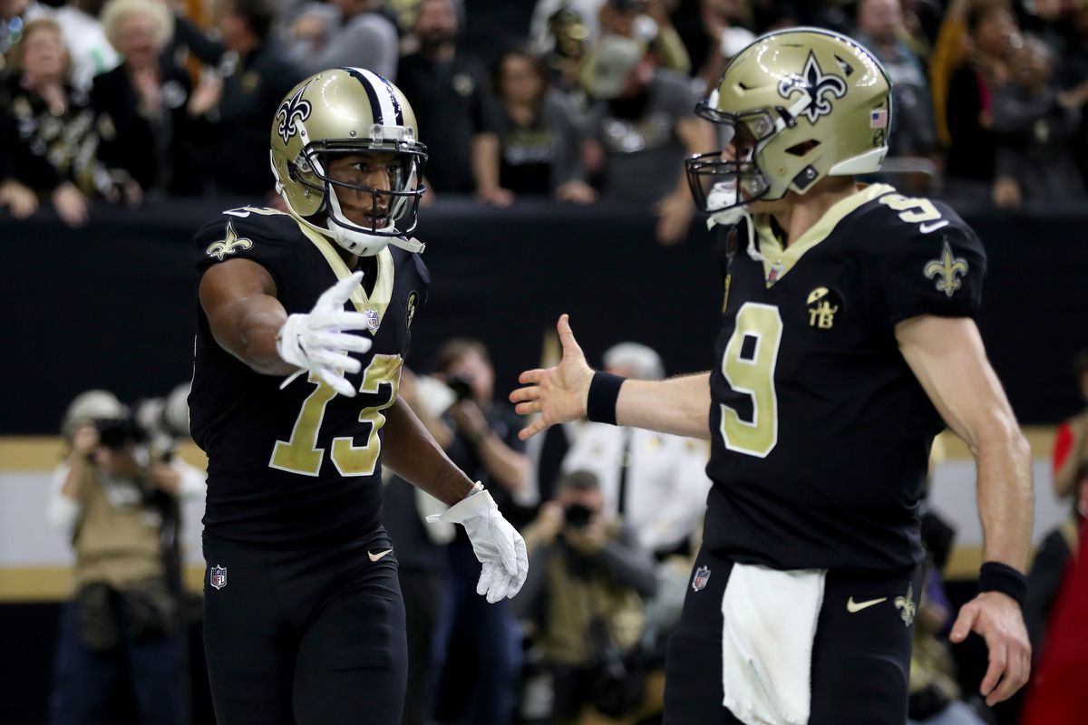 Michael Thomas #13 and Drew Brees #9 of the New Orleans Saints celebrate their third quarter touchdown against the Philadelphia Eagles in the NFC Divisional Playoff Game at Mercedes Benz Superdome on January 13, 2019 in New Orleans, Louisiana.
