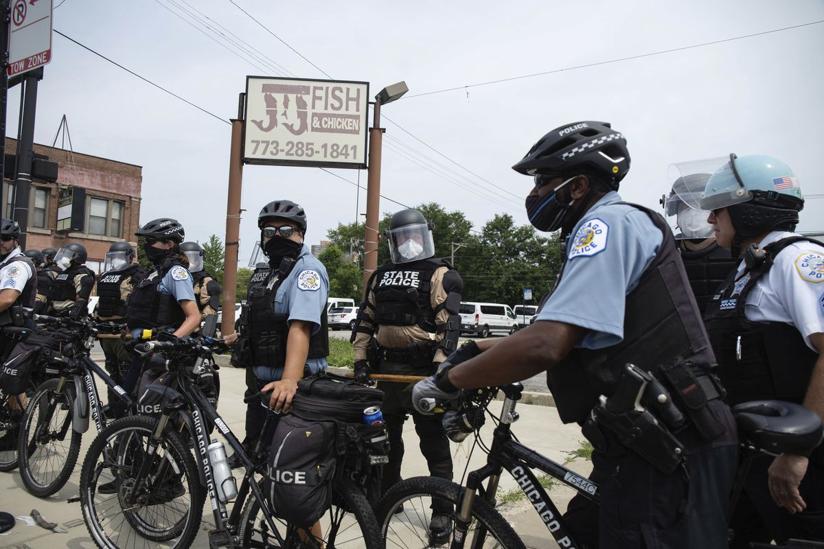 Chicago Police Department officers and Illinois State Police form a human barricade in the Bronzeville neighborhood during an anti-police brutality protest on Aug. 15, 2020.