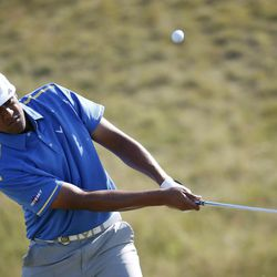 Tony Finau chips on the sixth hole during the third round of the PGA Championship golf tournament Saturday, Aug. 15, 2015, at Whistling Straits in Haven, Wis. (AP Photo/Julio Cortez)