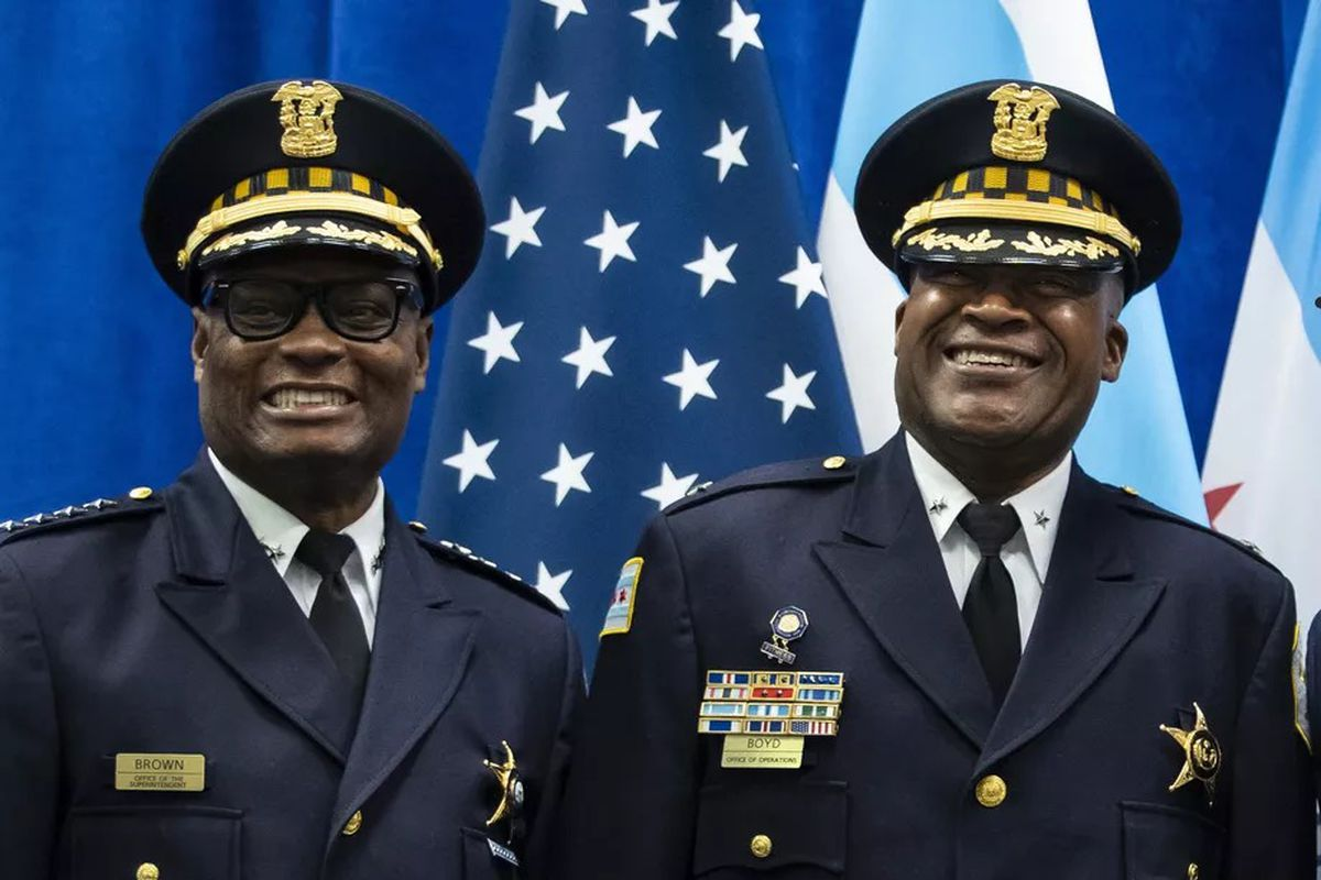 Chicago Police Department Deputy Chief of Criminal Networks Dion Boyd (right) with CPD Supt. David Brown at his promotion ceremony at CPD headquarters on July 15.
