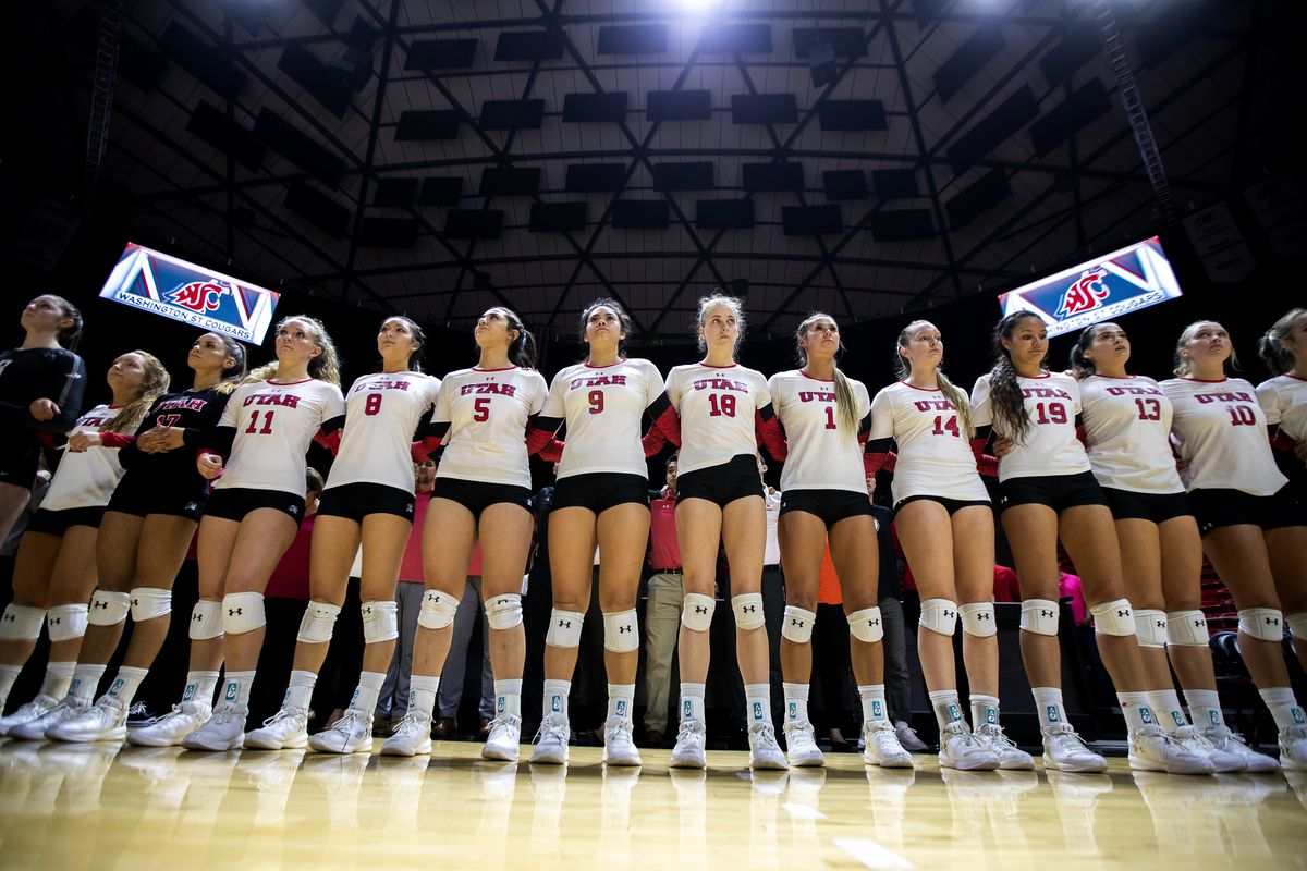 University of Utah women's volleyball team stand arm in arm for a moment of silence for fellow Utah student athlete Lauren McCluskey as the Utes prepare to play Washington State in the Huntsman Center in Salt Lake City on Wednesday, Oct. 24, 2018.