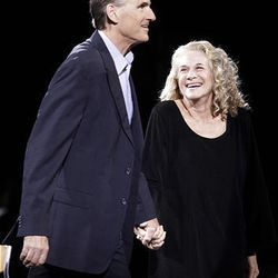 James Taylor and Carole King smile together during their concert at the the EnergySolutions Arena on Thursday.