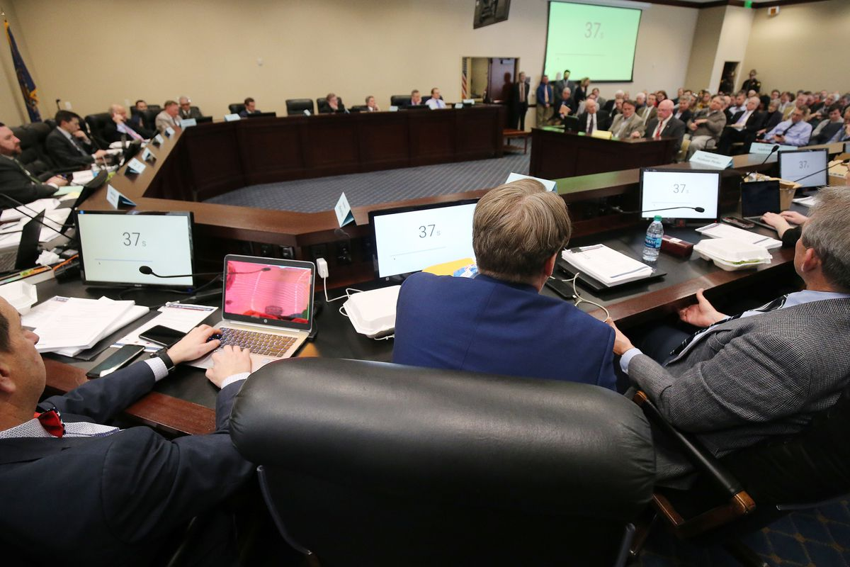 Lobbyists discuss the GOP leadership-backed tax reform bill during a meeting of House Revenue and Taxation Standing Committee at the Capitol in Salt Lake City on Friday, March 1, 2019.