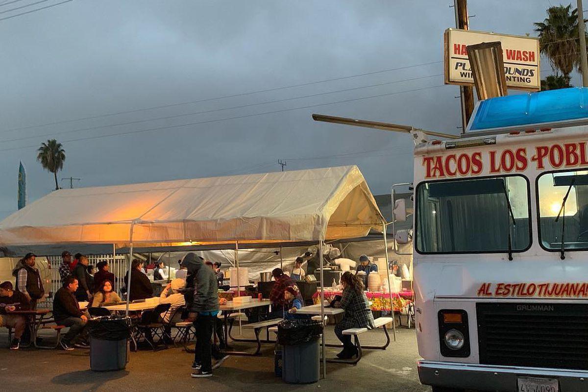 Taco truck los poblanos parking lot tent