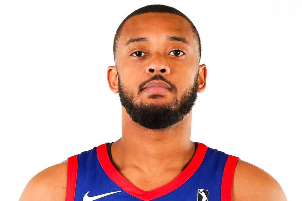 Zeke Upshaw's portrait wearing a blue jersey with red borders
