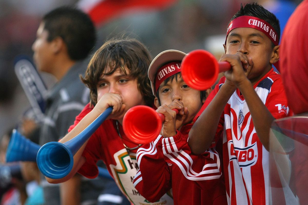 CARSON, CA - OCTOBER 02: Young fans doing their part for Chivas USA  (Photo by Victor Decolongon/Getty Images)