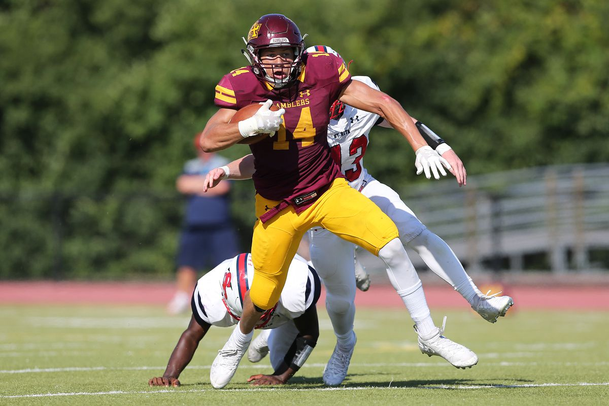 Loyola's Vaughn Pemberton (14) shakes a defender and picks up a few more yards.