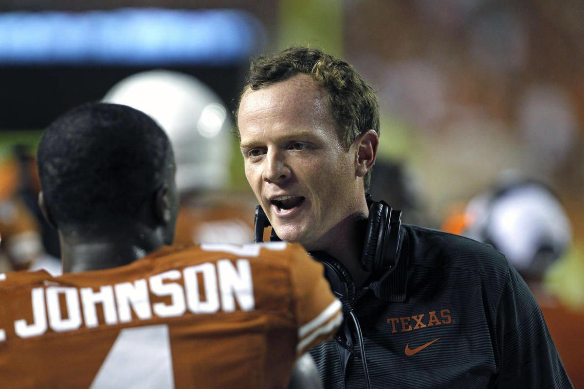 Texas offensive coordinator Major Applewhite talks with defensive back Daje Johnson during the third quarter of an NCAA college football game against New Mexico State, Saturday Aug. 31, 2013, in Austin, Texas.