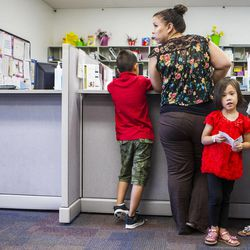 Carla Montilla, center, finishes up her visit at the Salt Lake County Health Department WIC Clinic in West Jordan with her children, Nicholas, 8, left, America, 4, and Karla, 6 on Tuesday, July 14, 2015. The Salt Lake County Health Department broke ground this morning for the new public health center that will accommodate the growing demand for health services.
