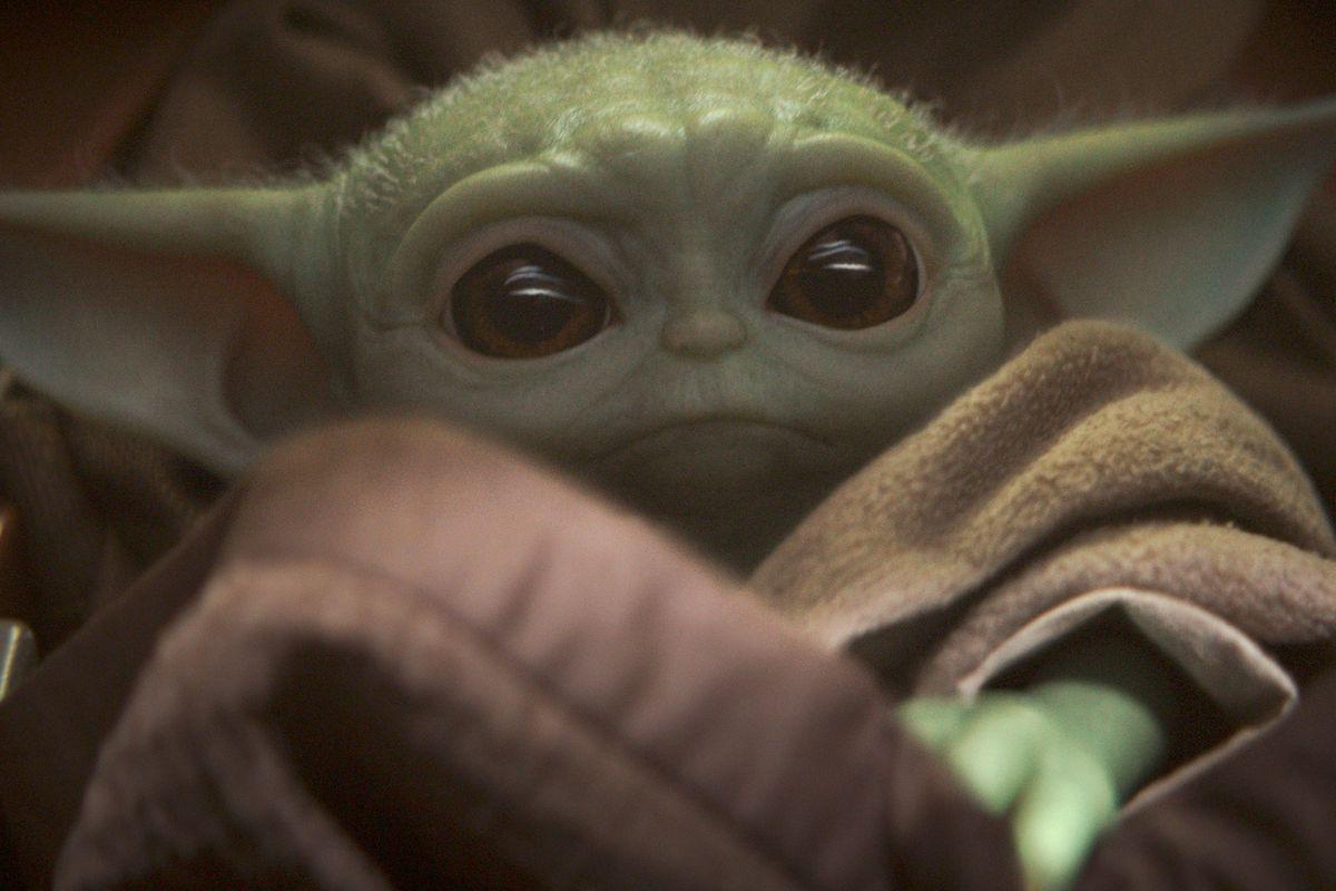 baby yoda sitting in his floaty crib on the mandalorian