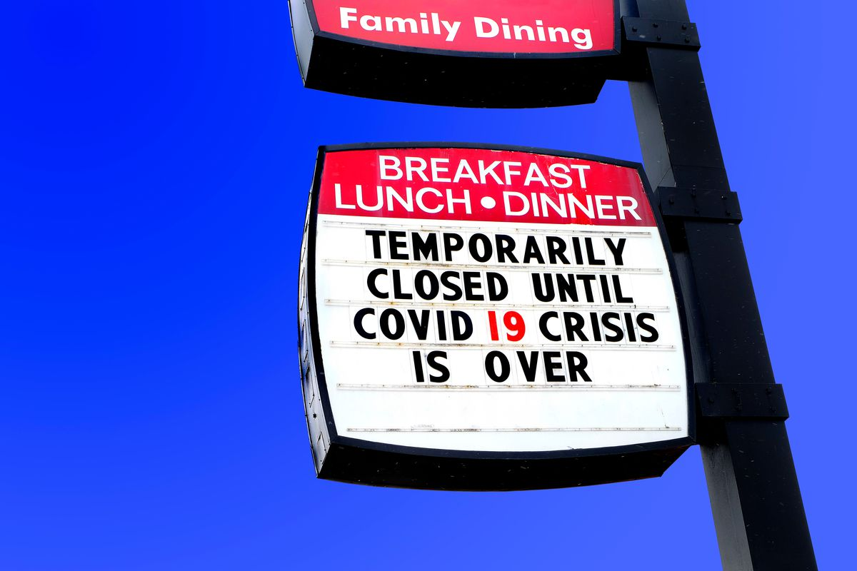 """Restaurant sign saying """"Temporarily closed until COVID 19 crisis is over."""""""