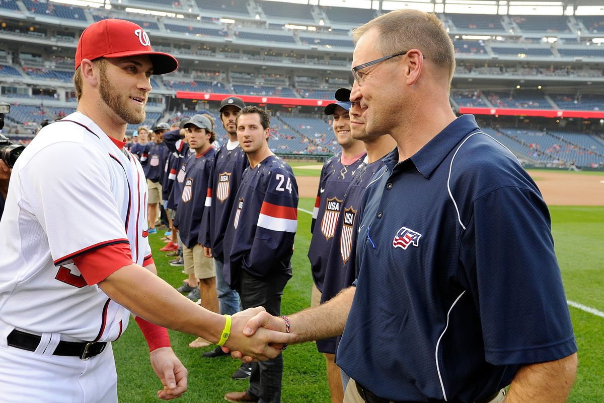 Team America desperately seeking Bryce Harper's approval of their new sweaters. Harper is fighting back disappointment.