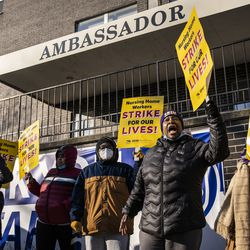 Annette Delaney, 54, a travel escort at Ambassador Nursing & Rehabilitation Center in Albany Park, leads a rally of striking Infinity Healthcare Management workers outside the Northwest Side facility Monday.