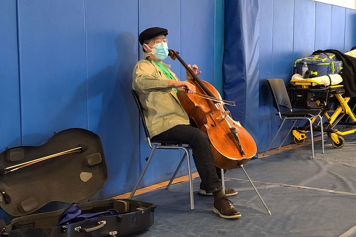 This photo provided by Berkshire Community College shows cellist Yo-Yo Ma performing at Berkshire Community College's second dose Pfizer vaccination clinic in the Paterson Field House on Saturday, March 13, 2021 in Pittsfield, Mass. Newly vaccinated Massachusetts residents were treated to a mini concert when the famed cellist brought out his instrument after getting his second shot.
