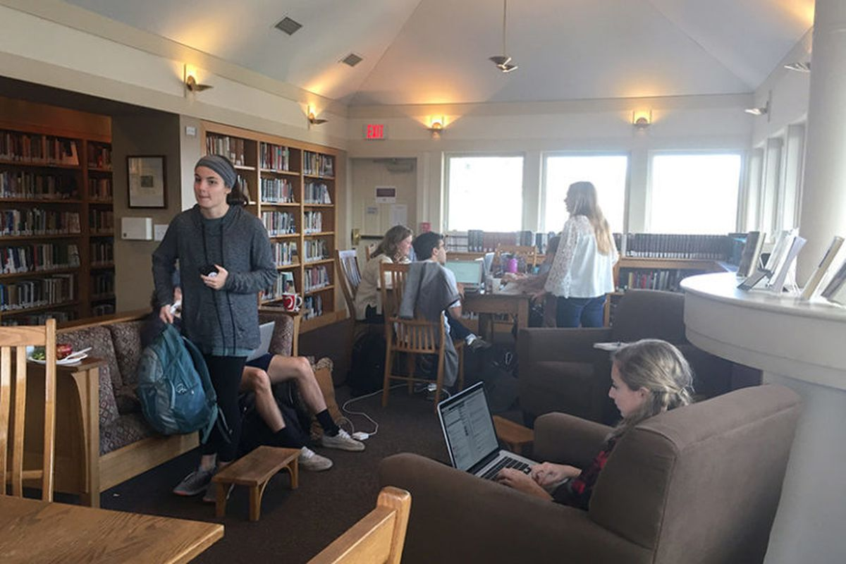 Students interact and study in the library of the Center for Christian Study at the University of Virginia in Charlottesville.