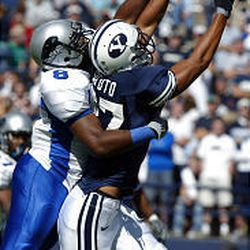 BYU freshman tight end Vic So'oto is defended by Eastern Illinois' George Love on Saturday in Provo.