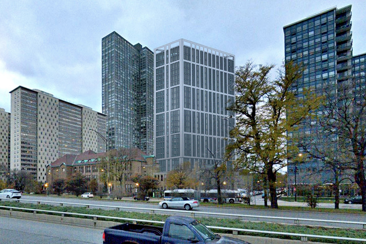 A tall building stands in line with other taller buildings next to low-rise school buildings along Lake Shore Drive.