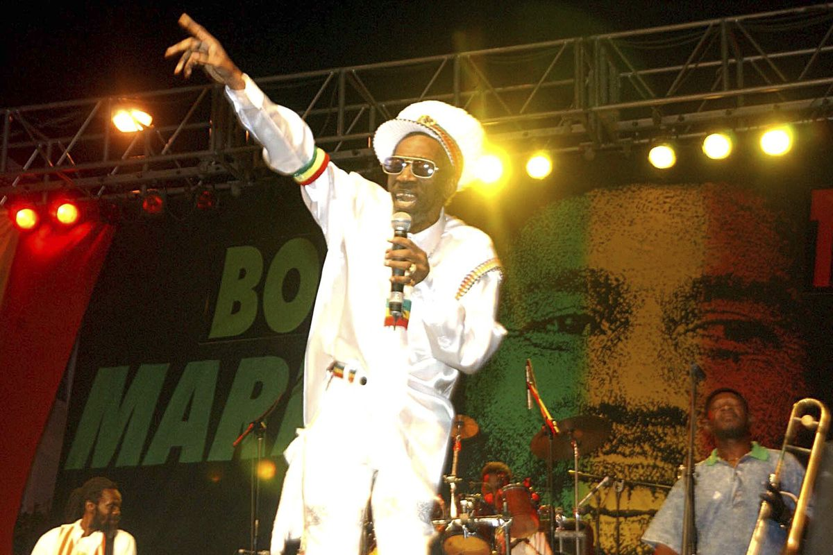 In this Feb. 6, 2005 file photo, Bunny Wailer performs at the One Love concert to celebrate Bob Marley's 60th birthday, in Kingston, Jamaica.