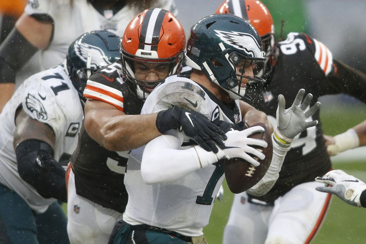 Cleveland Browns defensive end Olivier Vernon (54) sacks Philadelphia Eagles quarterback Carson Wentz (11) for a safety during the second half at FirstEnergy Stadium.