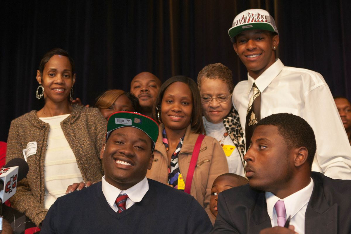 Alex Weber (white hat) after Laremy Tunsil signed with Ole Miss