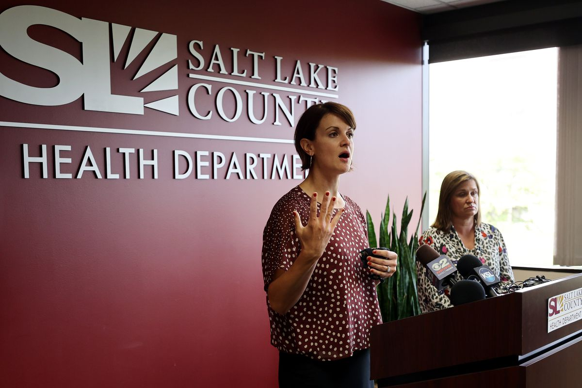 """Dr. Angela Dunn, executive director of Salt Lake County Health Department, left, discusses schoolchildren and masks as Salt Lake County Mayor Jenny Wilson listens at the Salt Lake County Government Center in Salt Lake City on Tuesday, Aug. 10, 2021.Children in the county under the age of 12 will be required to wear masks at school under an """"order of restraint"""" to be issued by Dunn."""