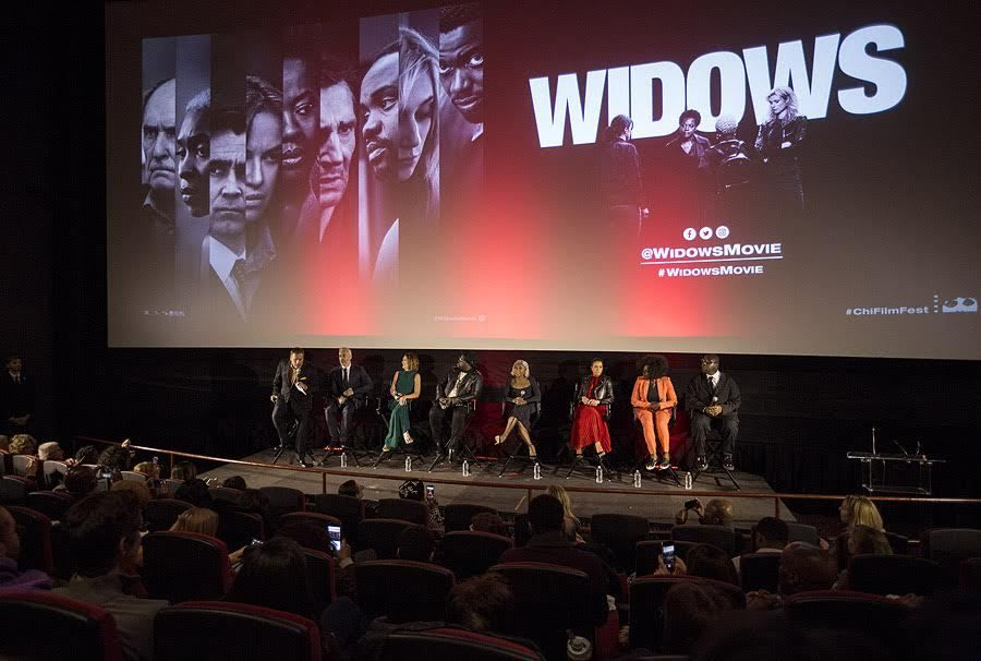 """Richard Roeper (left) leads a """"Widows"""" Q&A session with producer Iain Canning, screenwriter Gillian Flynn, actors Brian Tyree Henry, Cynthia Erivo, Michelle Rodriguez and Viola Davis and writer-director Steve McQueen as part of the Chicago Internation"""
