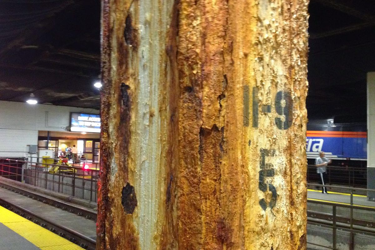 A rusty pillar on a boarding platform at Union Station.