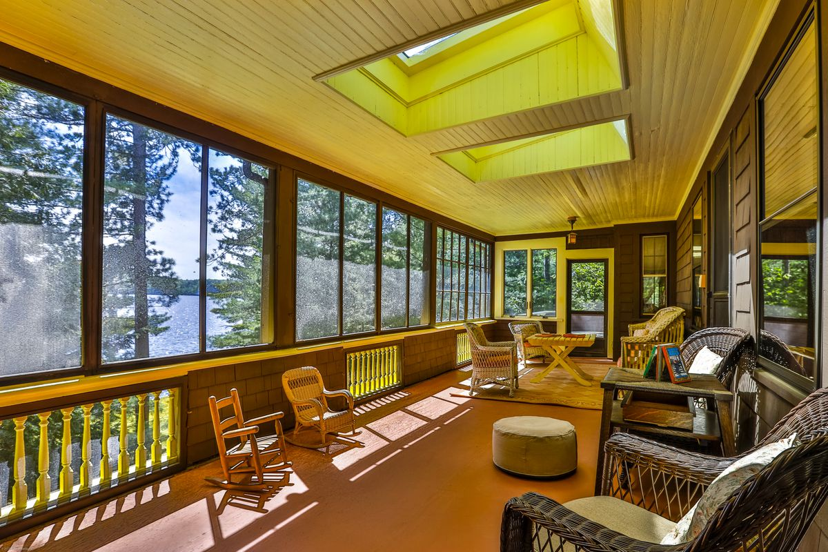 A second-story porch is screened in to protect against bugs.