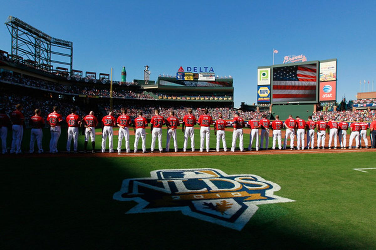 ATLANTA - OCTOBER 10:  The Atlanta Braves line up down the first base line to watch a replay of Rick Ankiel's home run.