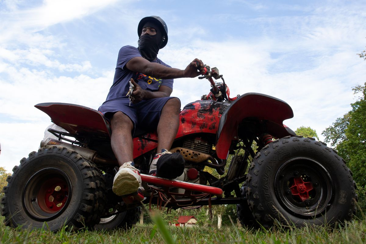 Jayson Felder took a break while riding ATVs with friends in Highland Park, Sept. 22, 2021.