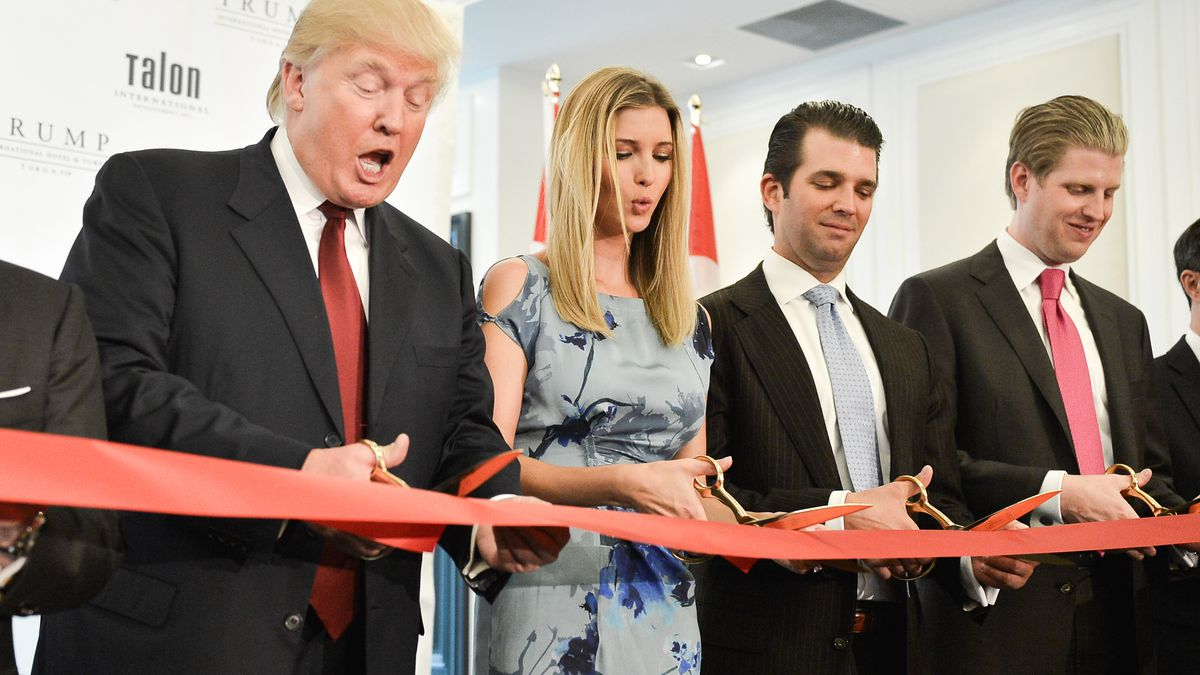Donald Trump cuts the ribbon at his International Hotel and Tower in Toronto, Canada.